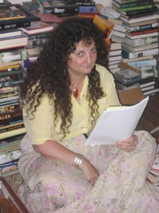 Ellen Datlow hard at work in front of her books
